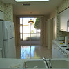 Kitchen looking into breakfast area Before