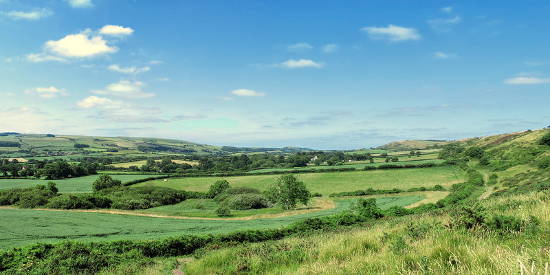 A panorama view of the valley ahead, looking West.
