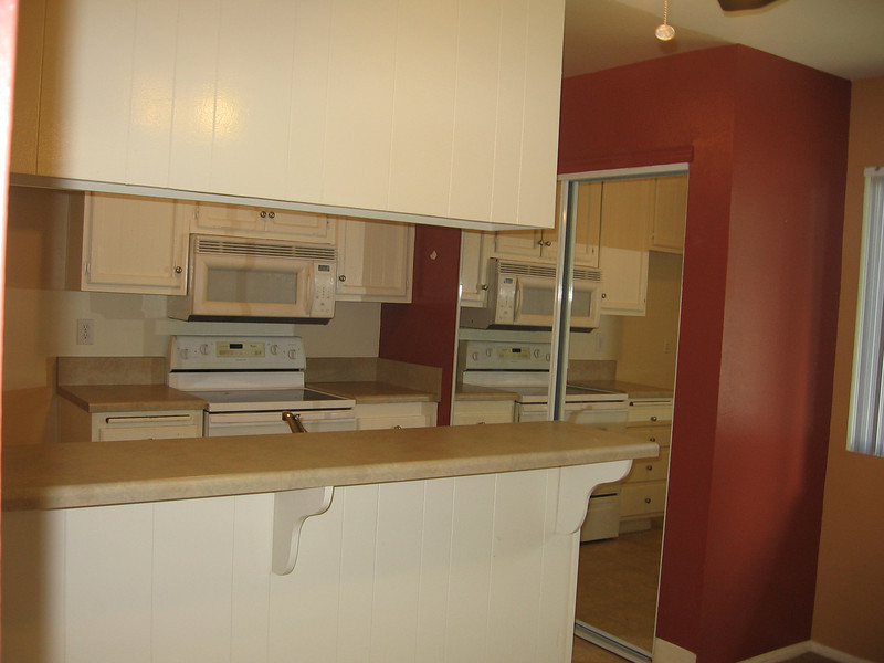 Kitchen with buil in Microwave, Electric Range. Pantry behind sliding glass doors