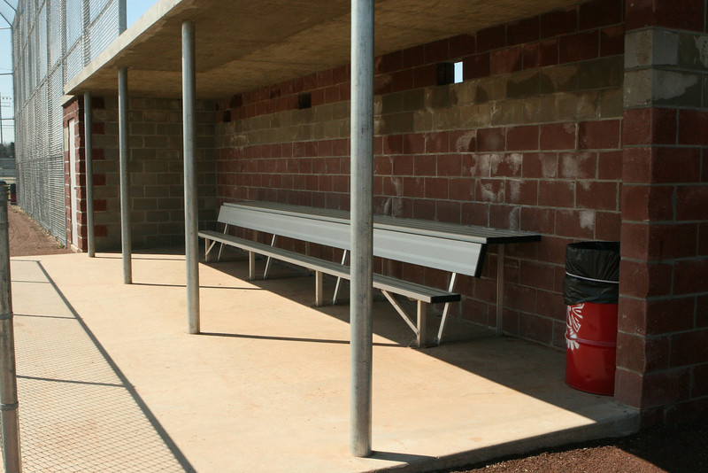 Dugouts equipped with a trash can. A TRASH CAN! The beauty is in the detail, folks.