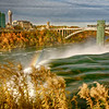 American Falls, rainbow, and rainbow bridge between Canada and the US.