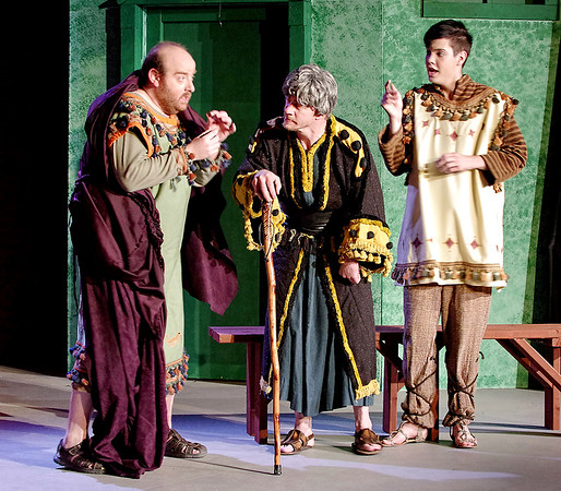 """Mark Maynard   for The Herald Bulletin<br /> Pseudolus (Daniel Draves), aided by Hysterium (Spencer Martin),  tells Erronius (Judge Morton) that he must walk seven times around the seven hills of Rome to banish a """"spirit"""" from his house."""