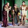 "Mark Maynard | for The Herald Bulletin<br /> Pseudolus (Daniel Draves), aided by Hysterium (Spencer Martin),  tells Erronius (Judge Morton) that he must walk seven times around the seven hills of Rome to banish a ""spirit"" from his house."