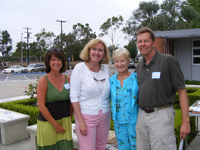 Former classmates Lauren Slaughter, Franci Vittrup, and Billy Beamish with their kindergarten teacher, Shirley Boezinger, standing outside their classroom at Mariners Elementary School during the mini-reunion on 8/3/2008.