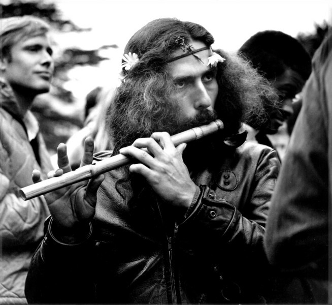 Once I discover Haight-Ashbury it becomes a favorite photographic destination. My short Navy hair and camera spooks the Hippies who assume I'm an undercover policeman. I'm mistrusted and given a wide berth by suspicious Flower People.  This probably saves my chromosomes from destructive encounters with sex and drugs. This flute player is especially paranoid when he notices my lens pointing his way. I was only able to snap a few shots before he fled in terror.