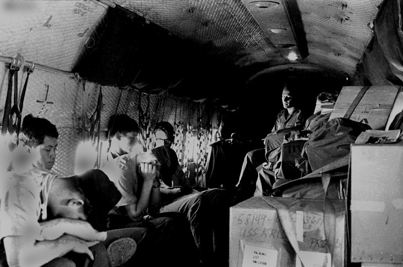 "We don't fly first class in the old Cargo 47, but bounce and rattle with the freight in the un-pressurized cabin. So this is a supply clerk's war I think—good. So be it, at least someday when little Billy is old enough to ask, ""Daddy what did do in the war?"" I'll tell him mostly I slept on a giant box of toilet paper and took pictures of dozing clerks. Not too impressive my boy, but at least I'm here. Experimenting with the new camera also inspires me to switch from Plus-X-Pan film to the faster Tri-X-Pan. I shoot color slide for the Navy and black and white for me. The low light in the C47 hull makes me glad to have the extra  F-stops."
