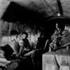 """We don't fly first class in the old Cargo 47, but bounce and rattle with the freight in the un-pressurized cabin. So this is a supply clerk's war I think—good. So be it, at least someday when little Billy is old enough to ask, """"Daddy what did do in the war?"""" I'll tell him mostly I slept on a giant box of toilet paper and took pictures of dozing clerks. Not too impressive my boy, but at least I'm here. Experimenting with the new camera also inspires me to switch from Plus-X-Pan film to the faster Tri-X-Pan. I shoot color slide for the Navy and black and white for me. The low light in the C47 hull makes me glad to have the extra  F-stops."""