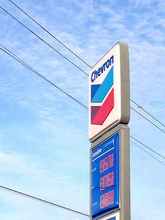 It's not that I'm advertising Chevron or protesting the prices; I liked the sign against the blue sky and the electrical wires.