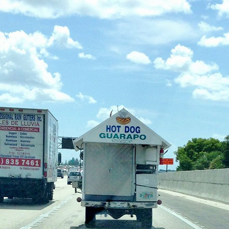 It's a converted Jeep Wrangler / hot dog and guarapo food truck. There is a deer head mounted to the top of the windshield. Is this an only in Miami sighting?
