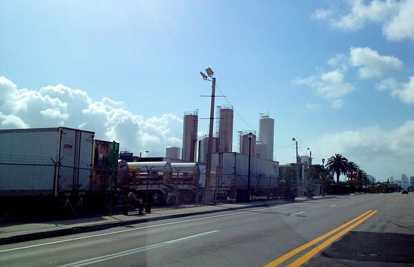 Another photo taken from a moving vehicle. I like the industrial look and the palm tree in the distance. It's the McArthur Dairy facility which was also in Bad Boys II.
