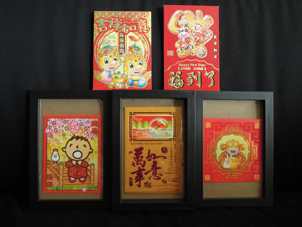 Hong Bao are Chinese envelopes that hold money. They are given out for Chinese New Year as well as other special occasions like birthdays. They have gotten much more colorful and cute since I was little. Here's part of my collection.