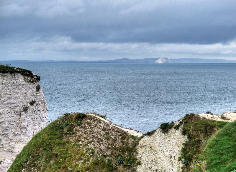 The Old Harry Rocks with the Isle of Wight in the distance