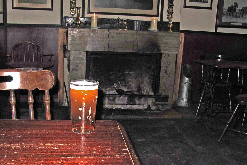 A welcome pint of Isle of Purbeck Brewery (brewed on the premises) 'Solar Power' bitter in front of an aromatic log fire to keep off the early evening chill at the Bankes Arms, Studland.