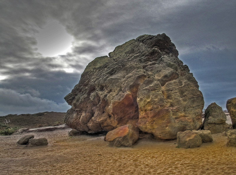 The Agglestone - in mystic mood.<br /> It is a sandstone block of about 400 tonnes weight and legend has it that the devil threw the rock from the Isle of Wight with the intention of hitting Corfe Castle.   He missed by several miles!