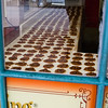 A Praline shop window showing a number of the delightful candies. Loaded with pecans and lots of sweetness, it is a weight watchers downfall. Ummm good!!!