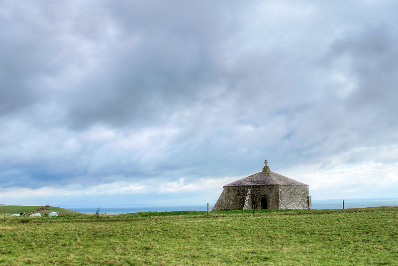The Norman Chapel at St Aldhelm's head, starkly stout on the exposed headland.