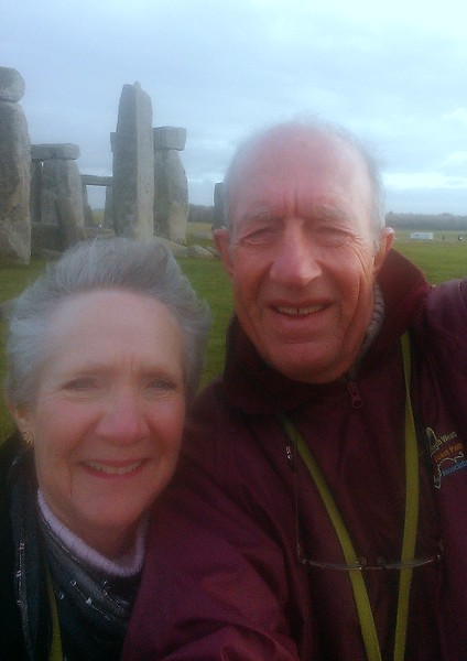 Two cold old people doing a rather self conscious 'selfy' at the stones.