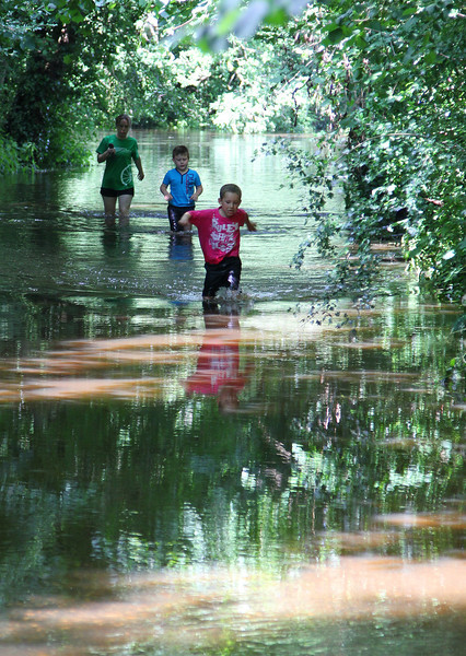 Children frolic in the very unusual mid-summer flooding.