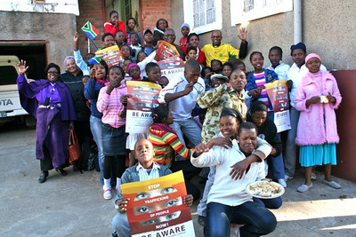 Frs. Joshua and Ntsikelelo with some of St. Teresa's youth.  Human trafficking and smuggling is an incredible problem. 187 young people from St. Teresa Mission were a part of larger youth gathering working to bring to light the issue in the wake of the World Cup. Here some of the young people hold up the posters that encourage young people not to fall prey to traffickers.