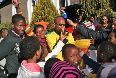 Fr. Ntsikelelo blows the vuvuzela, a horn that is often blown in South African stadiums during soccer games.