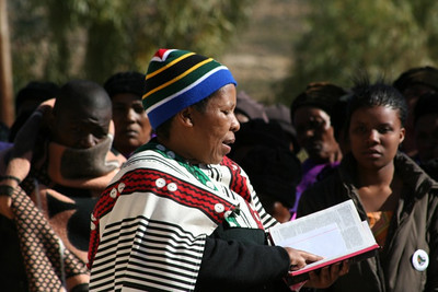 A member of the St. Teresa community does a reading.