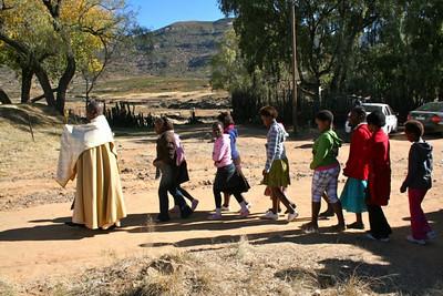 Fr. Joshua Mpiti leads the Corpus Christi procession St. Teresa Mission.