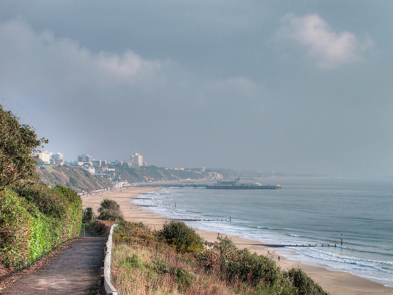 The view eastwards from the West Cliff, with Bournemouth and Boscombe sea fronts and the two piers.