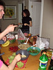 A view of the potluck spread; Rochelle (in the back) brought a great shredded cabbage sald that you can see with the two spoons sticking out.