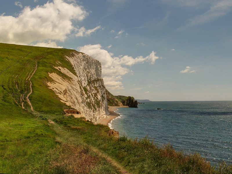 Swyre Head, and beyond showing Durdle Door in the middle distance.