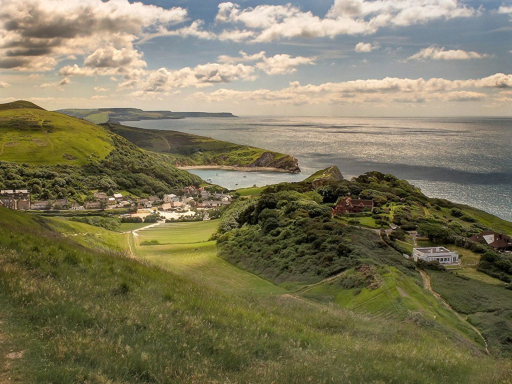 The view back from Hanbury Tout of Lulworth Cove with St Aldhelm's Head in the distance.
