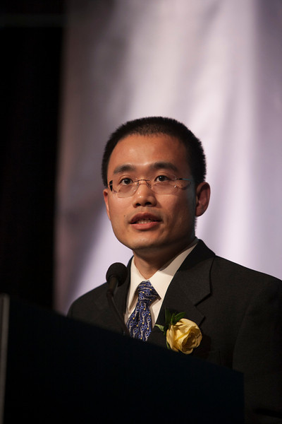 292.0Chicago, IL - The AACR Annual Meeting 2012:  Yibin Kang, PhD, 32nd Annual AACRAward for Outstanding Achievement in Cancer Research Award recipient,  speaks  at the AACR Awards Reception and Program during the the American Association for Cancer Research Annual Meeting here today, Sunday, April 1, 2012. More than 18,000 physicians, researchers, health care professionals, cancer survivors and patient advocates are expected to attend the meeting at McCormick Place. The Annual Meeting highlights the latest findings in all major areas of cancer research from basic through clinical and epidemiological studies. Date: Sunday, April 1, 2012 Photo by © AACR/Todd Buchanan 2012 Technical Questions: todd@toddbuchanan.com; Phone: 612-226-5154.