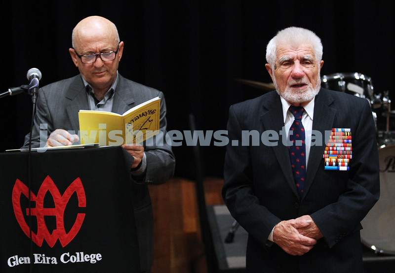 19-4-12. Yom Ha shoah memorial at Glen Eira College. Russian red army veteran Piter Kravchenko (right) recites a poem with  Gennady Vilkhov, grand father of student Benjamin Weintraub  translating at the school assembly. Photo: Peter Haskin