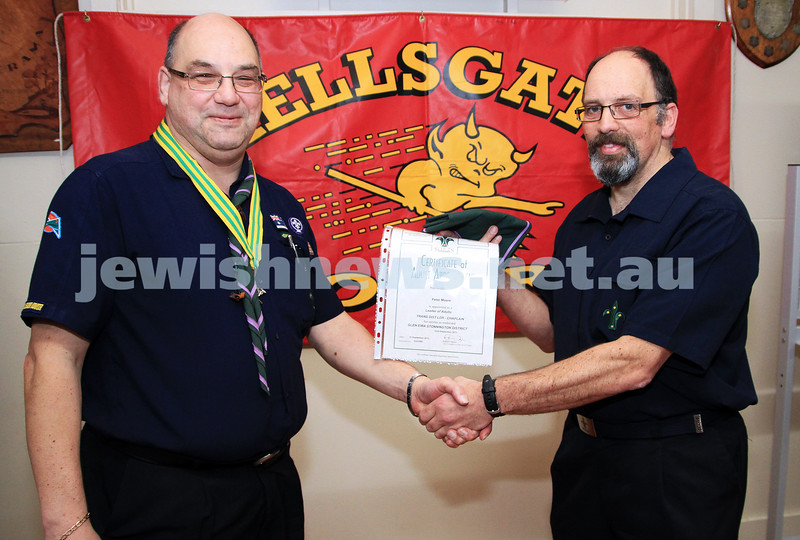 19-9-12. Photo: Peter Haskin. Rabbi Peter Moore (right)  with his brother Frank Moore, being invested as a scouting chaplain at the Glen Eira/Stonnington district scout hall.  Not since Rabbi Jacob Danglow (1880-1962) has there been an Orthodox Jewish Chaplain in the Scout Association. There has only been one other Jewish scouting chaplain, Rabbi Seth Phillips of the Leo beck centre who was a scouting chaplain for a short time in the mid 1980's. Rabbi Moore will be the chaplain for the Glen Eira Stonnington district which encompasses the area from Albert Park to Chadstone which includes Melbourne's three remaining Jewish Scout Groups (3rd St Kilda, 10th Caulfield and 15th Brighton).