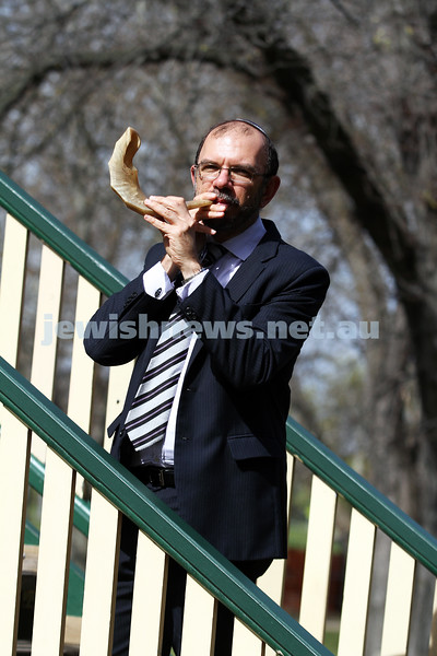 10-9-12.  Caulfield Hebrew Congregation's Rabbi Ralph Genende blows the shofar at Caulfield Park. Photo: Peter Haskin