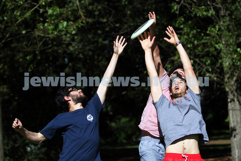 22-10-12. Playing frisbee in Caulfiedl Park. Glen Eira Council have decided not charge for a permit to play frisbee in the park. From left: Ben Grodeck, Daniel Crook, Ben Scholl. Photo: Peter haskin
