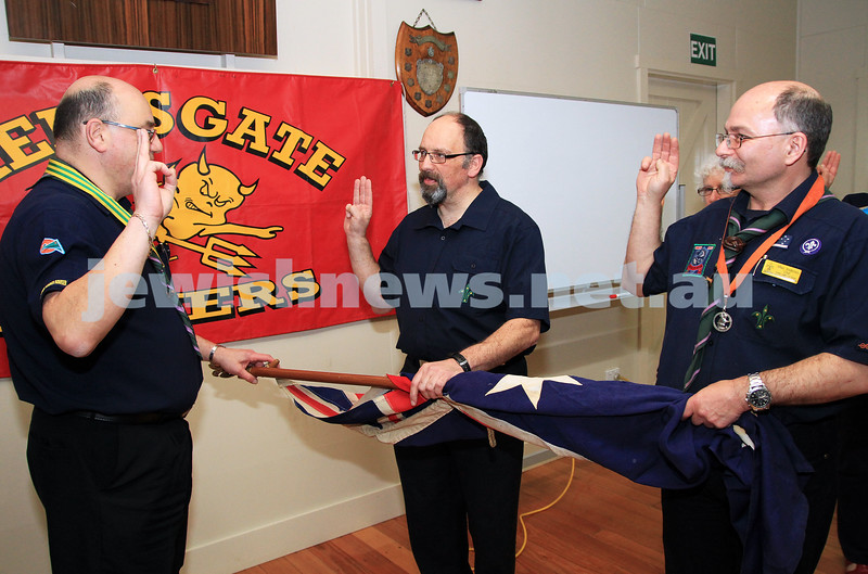 19-9-12. Photo: Peter Haskin. Rabbi Peter Moore (centre) being invested as a scouting chaplain at the Glen Eira/Stonnington district scout hall.  Not since Rabbi Jacob Danglow (1880-1962) has there been an Orthodox Jewish Chaplain in the Scout Association. There has only been one other Jewish scouting chaplain, Rabbi Seth Phillips of the Leo beck centre who was a scouting chaplain for a short time in the mid 1980's. Rabbi Moore will be the chaplain for the Glen Eira Stonnington district which encompasses the area from Albert Park to Chadstone which includes Melbourne's three remaining Jewish Scout Groups (3rd St Kilda, 10th Caulfield and 15th Brighton).