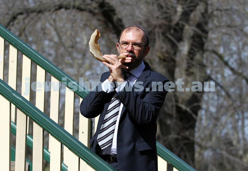 10-9-12.  Caulfield Hebrew Congregation's Rabbi Ralph Genende blows the shofar at Caulfield Park. Photo: Peter Haskin
