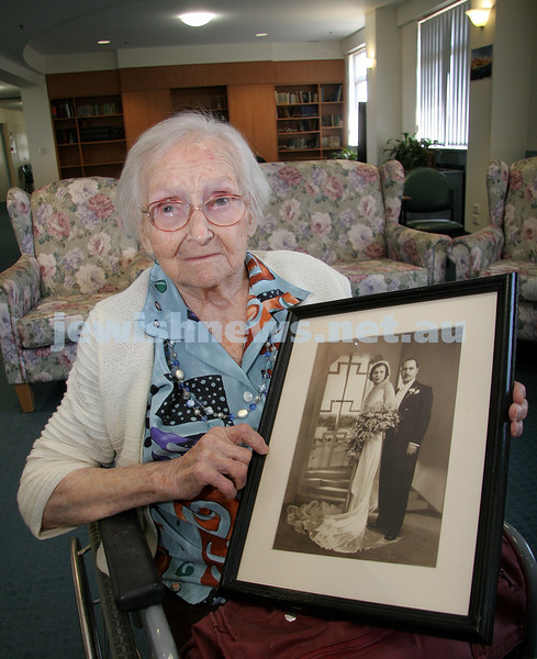 Mary Rothstein. Turning 106 yrs old in 2007. Jewish Care / Montefiore. Holding wedding photo. photo: peter haskin