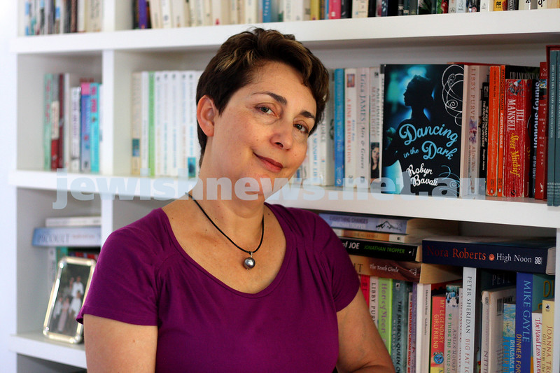 """8/2/10. Robyn Bavati with her book """"Dancing in the Dark"""". Photo: Peter Haskin"""