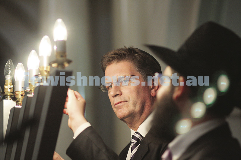 14/12/09. Chanukah at Queens Hall, Parliament House , Victoria. Rabbi Chaim Herzog from Chabad CBD lights the menorah with Victorian Oppostion Leader  Ted Baillieu. photo: peter haskin