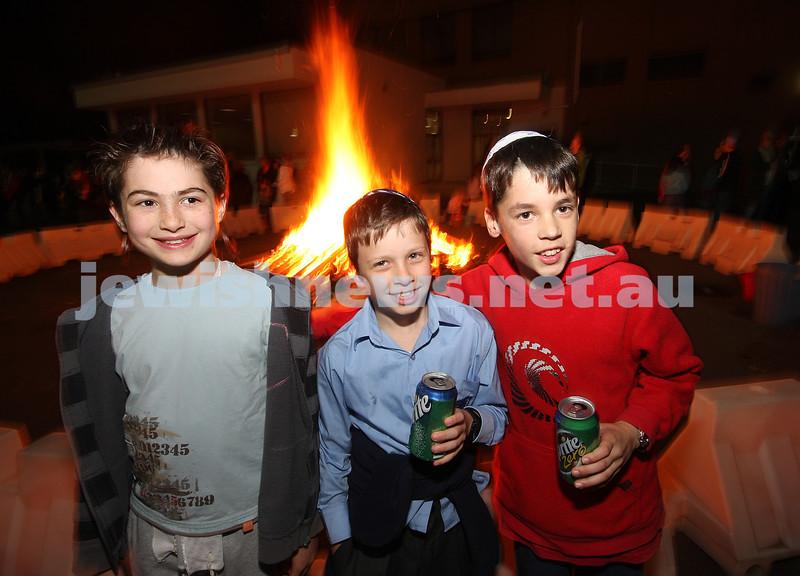 Bnai Akiva Lag B'omer celebrationa at Mizrachi. From left: Nethaniel Sor, Ronin Rosenbloom, Zac Trytell. photo: peter haskin