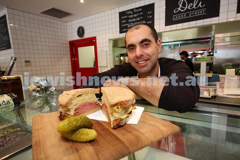 Adam Faigen with his award winning Reubens sandwich. Voted best sandwich in melbourne 2009. photo: peter haskin