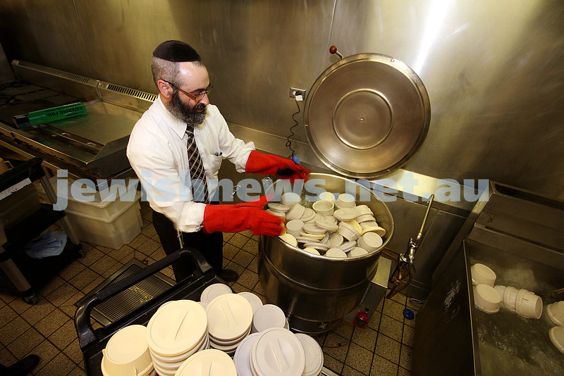 Jewish Care's Rabbi Kluwgant pitching in with koshering the Montefiore kitchens for Pesach. More than 1,200 kosher pesach meals are prepared each day. Photo: Peter Haskin