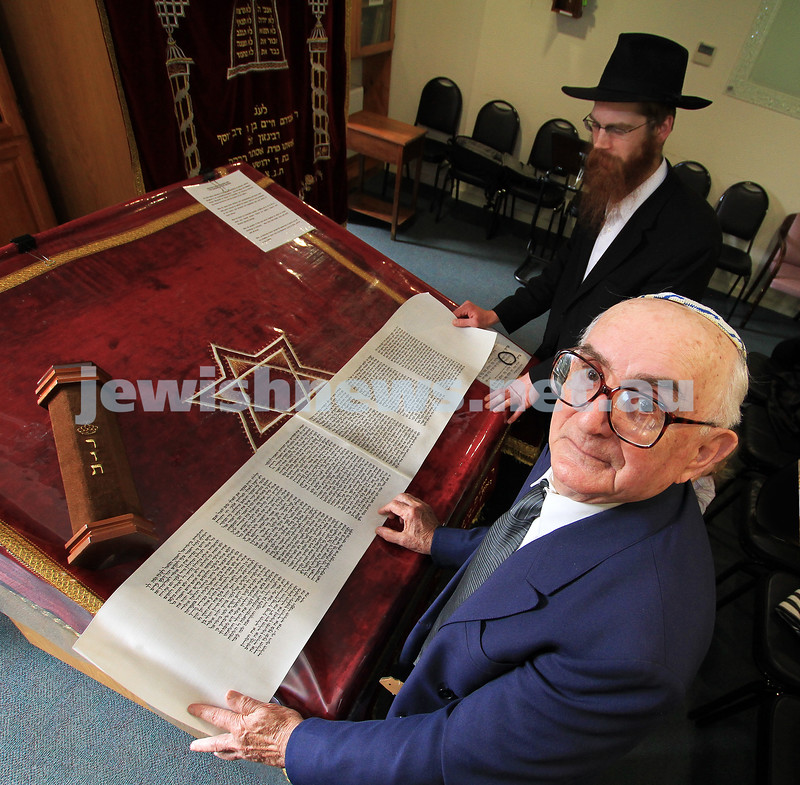Josef Rewinson with the Megillat Rut he donated to the Emmy Monash shul. Seen here with the Megillat and Rabbi Michal Stern. photo: peter haskin
