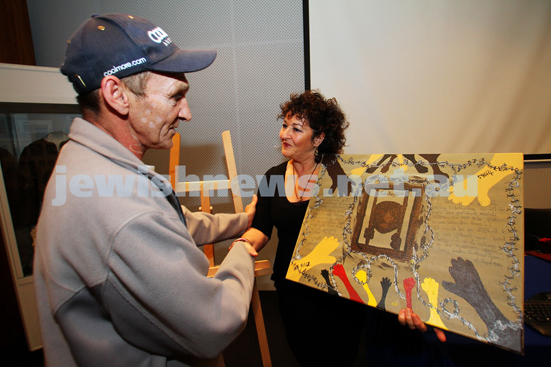 2-5-11. Artist Stephen xxxxxxx presents his piece to Jewish Holocaust Centre President Pauline Rockman. Photo: Peter Haskin