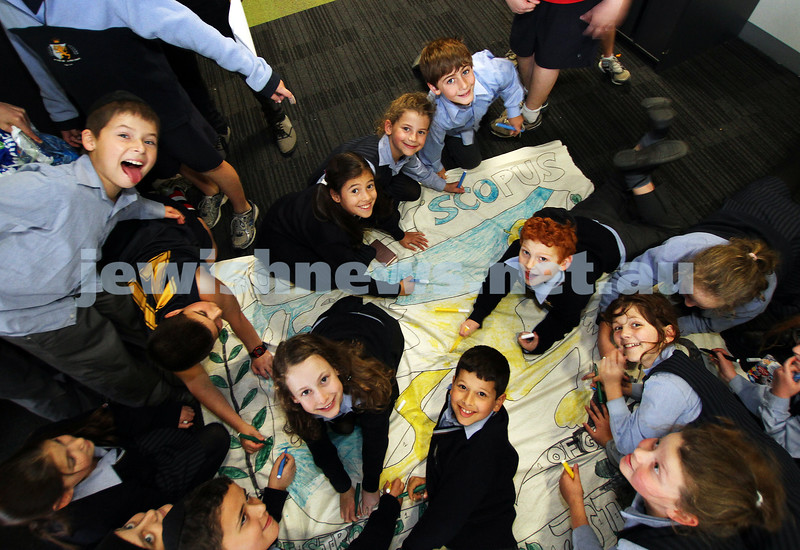 13-5-11. Mount Scopus Primary students working on their banner for the Lag B'omer parade. Photo: Peter Haskin