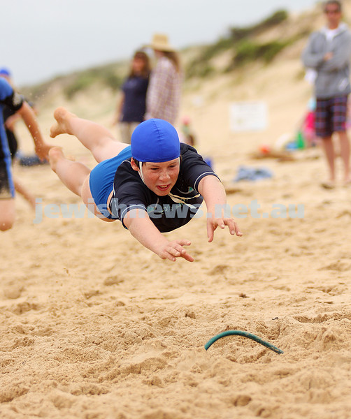 Nathan Blecher. 11 yrs old. Woolamai surf life saving club. participating in the Nippers program. Launching himself during the flag races. January 2009. photo: peter haskin
