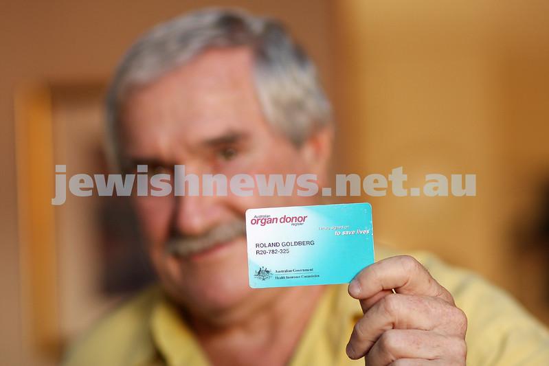 16/2/10. Organ donor campaigner Ronny Goldberg holding his organ donor card. Photo: Peter Haskin