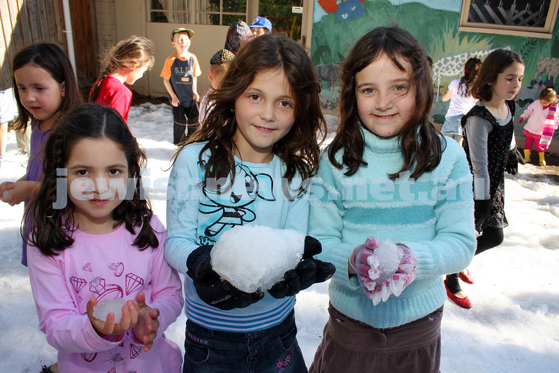 14/12/09. Chanukah. A winter wonderland of chanukah fun at Chabad Glen Eira where snow was dumped for the kids. From left: Skye Givoni, Tal Cohagnka, Sara Segal. Photo: Peter Haskin