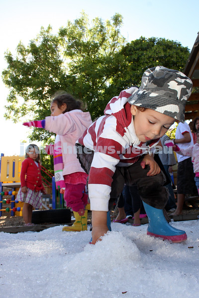 14/12/09. Chanukah. A winter wonderland of chanukah fun at Chabad Glen Eira where snow was dumped for the kids. Zvi Rubin gathering up a snow ball. Photo: Peter Haskin